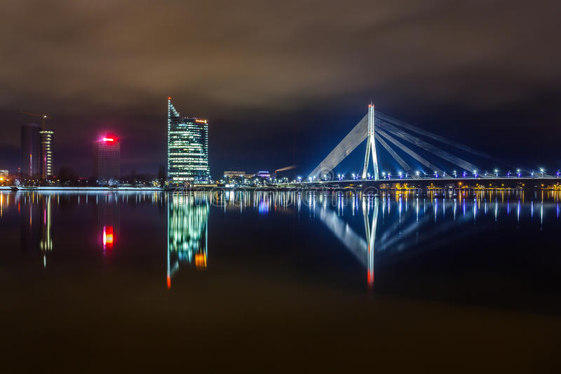 Lovely Riga. Night city view of Riga, the capital of Latvia, illuminated Vansu bridge reflection on Daugava river
