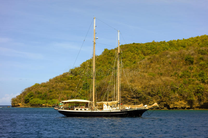A lovely schooner at anchor in the caribbean stock image