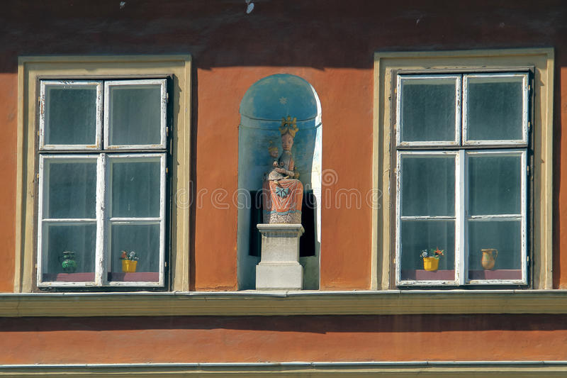 Download Lovely Sculpture Of A Woman Between Windows Stock Photo - Image of building, clear: 83722446