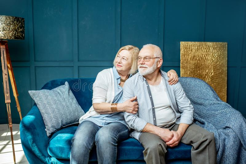 Lovely senior couple at home stock images