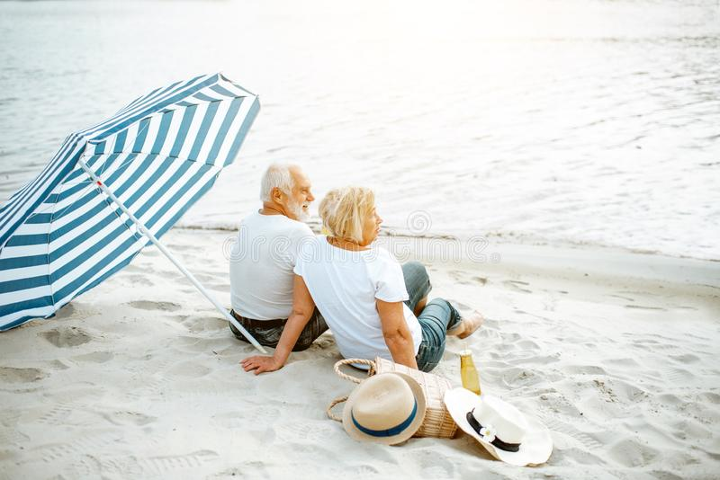 Senior couple on the beach stock image