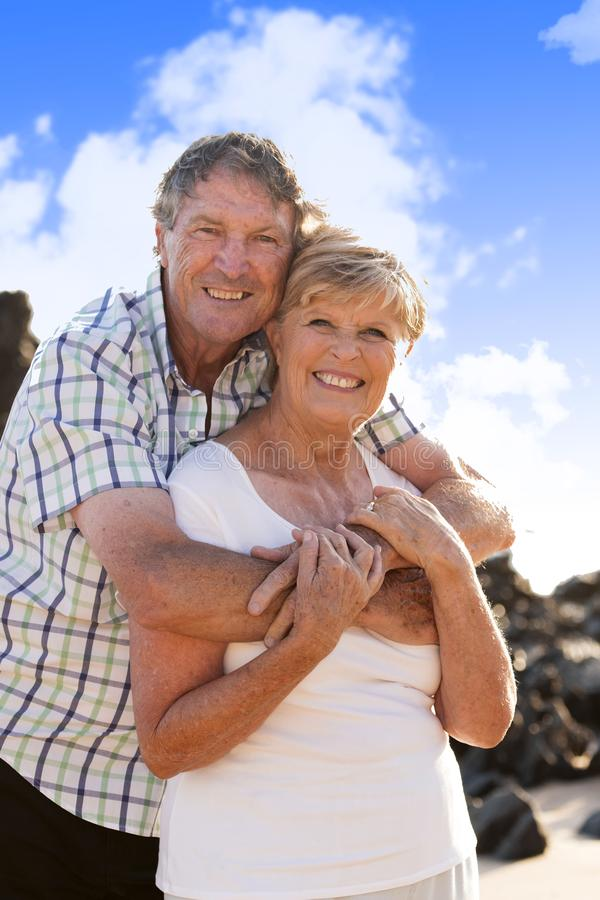 Lovely senior mature couple on their 60s or 70s retired walking happy and relaxed outdoors under a blue sky in love romantic aging royalty free stock photography