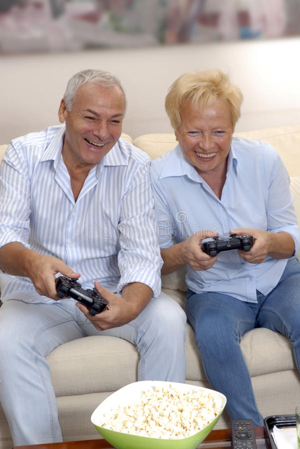 Download Lovely senior playing.. stock photo. Image of video, play - 24682270