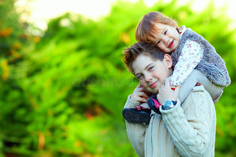 Lovely siblings having fun outdoors stock images