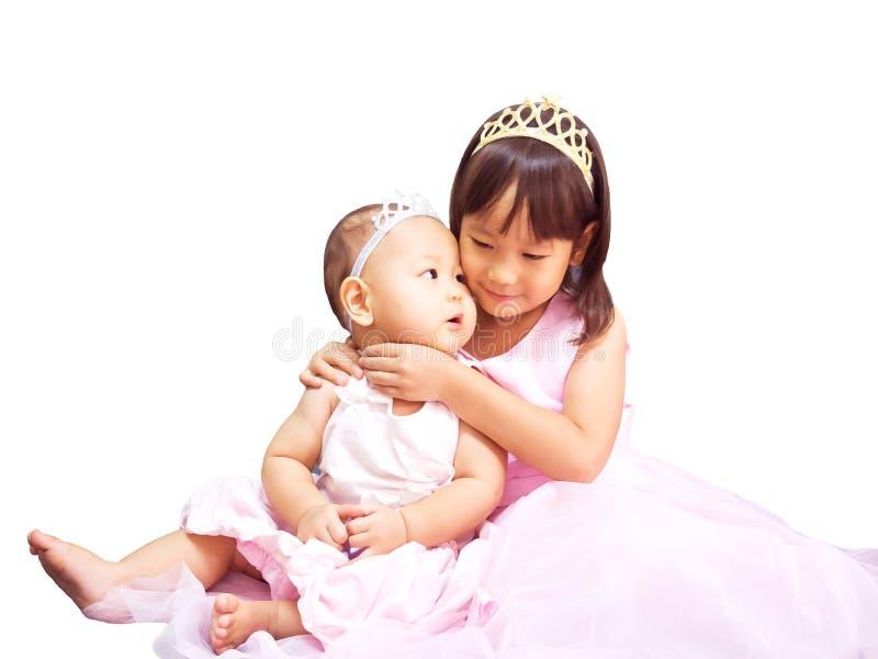 Lovely sister hug together. stock photos
