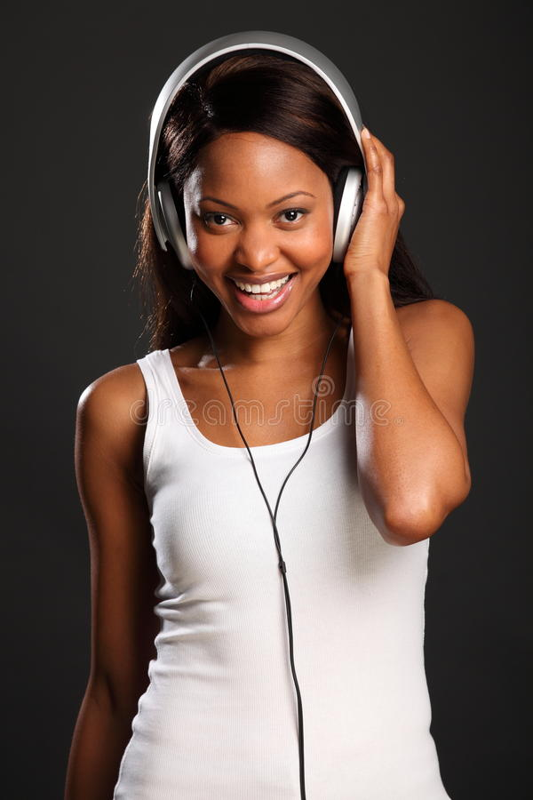 Lovely smile by beautiful black woman music fan stock image