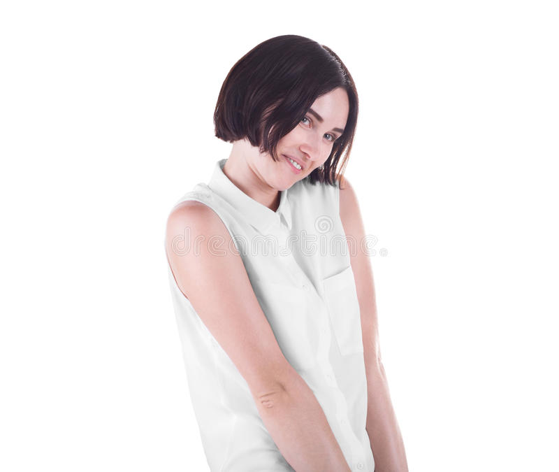 A lovely smiling girl isolated on a white background. A playful female with a short haircut. A romantic and cute young lady. royalty free stock photos