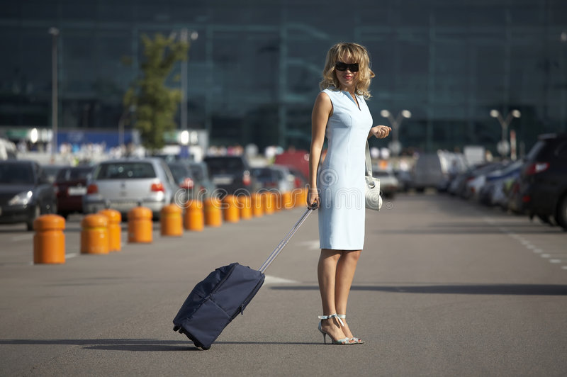 Download Lovely Smiling Woman Traveling With A Suitcase Stock Photo - Image: 7748284