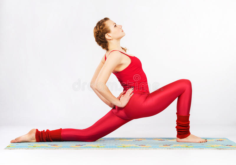 Lovely sporty woman doing stretching exercise. Beautiful sporty woman doing stretching exercise royalty free stock photos