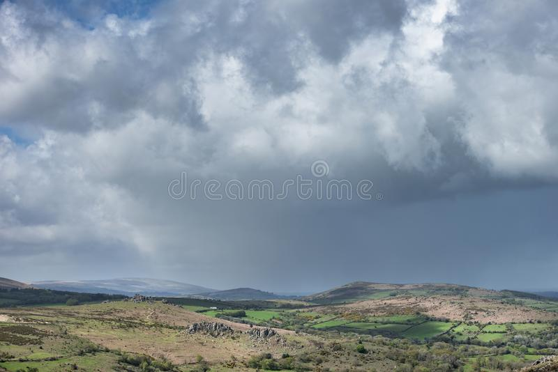 Lovely Spring landscape image of view from Haytor in Dartmoor National Park in Devon England on lovely sunny Spring day. Beautiful Spring landscape image of view royalty free stock image