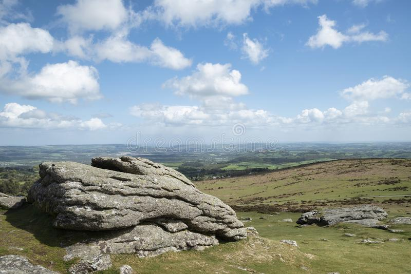 Lovely Spring landscape image of view from Haytor in Dartmoor National Park in Devon England on lovely sunny Spring day. Beautiful Spring landscape image of view royalty free stock images