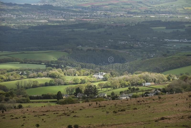 Lovely Spring landscape image of view from Haytor in Dartmoor National Park in Devon England on lovely sunny Spring day. Beautiful Spring landscape image of view stock photos