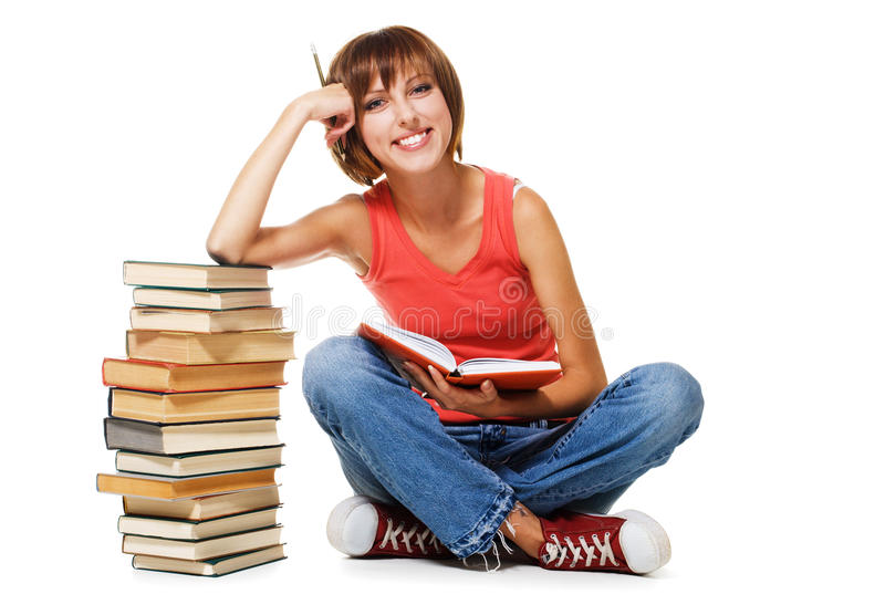 Lovely student with a stack of books. Isolated on white royalty free stock photos