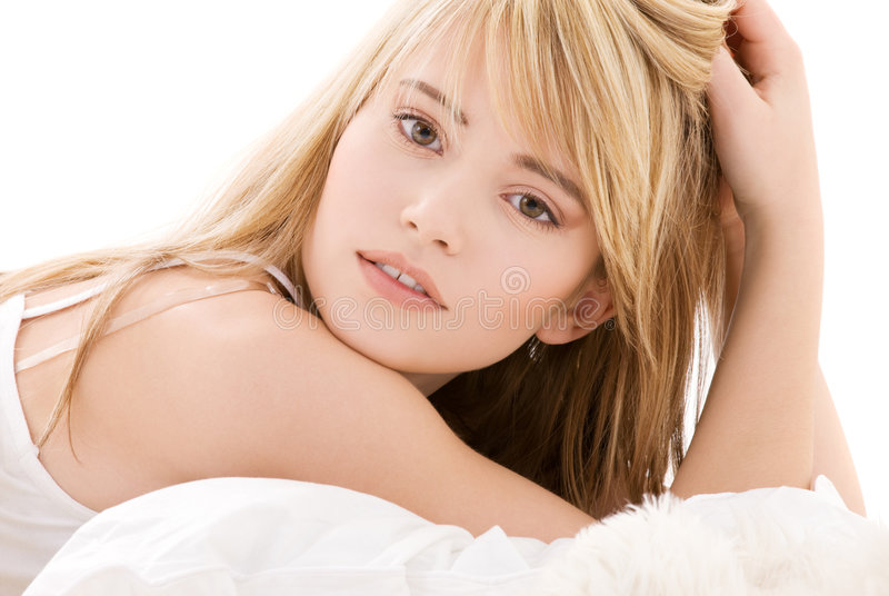 Lovely teenage girl. Bright picture of lovely teenage girl in white cotton shirt stock photography