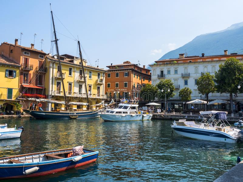 The lovely town of Malcesine on Lake Garda where is famous castle guards the entrance to its harbour. Lake Garda is a popular European tourist destination and stock photography