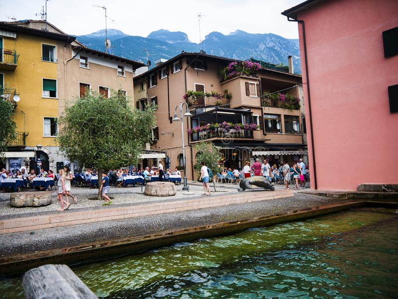 The lovely town of Malcesine on Lake Garda where is famous castle guards the entrance to its harbour. Lake Garda is a popular European tourist destination and royalty free stock image