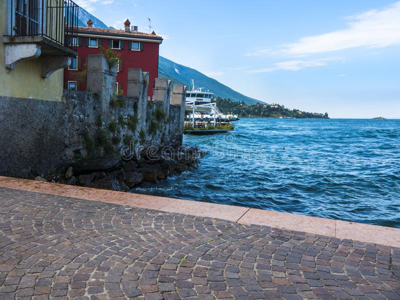 The lovely town of Malcesine on Lake Garda where is famous castle guards the entrance to its harbour. Lake Garda is a popular European tourist destination and stock images