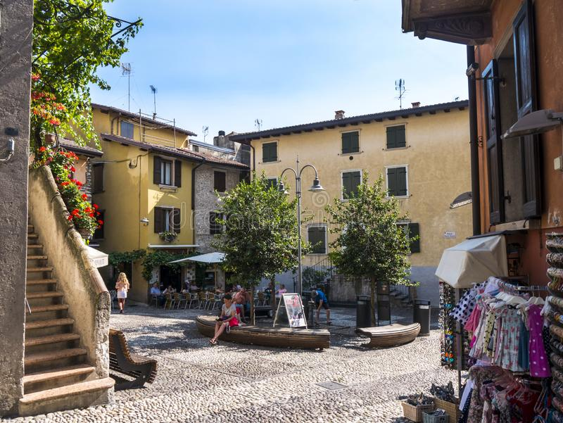 The lovely town of Malcesine on Lake Garda where is famous castle guards the entrance to its harbour. Lake Garda is a popular European tourist destination and royalty free stock photography
