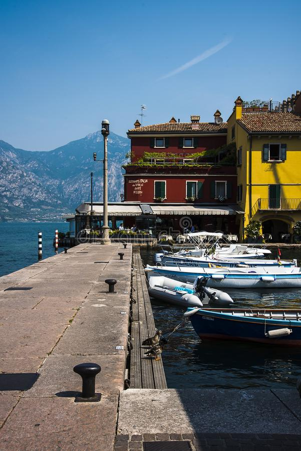 The lovely town of Malcesine on Lake Garda where is famous castle guards the entrance to its harbour. Lake Garda is a popular European tourist destination and royalty free stock photos