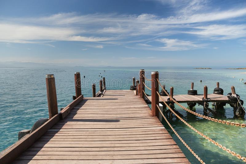 A wooden boardwalk in Kota Kinabalu in Malaysia. A lovely view from a wooden boardwalk in Kota Kinabalu in Malaysia stock photos