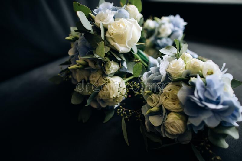 Lovely wedding bouquets with blue and white flowers for the bride and her friends.  royalty free stock photos