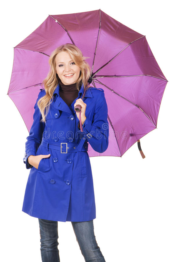 Lovely woman in blue coat with umbrella royalty free stock photography