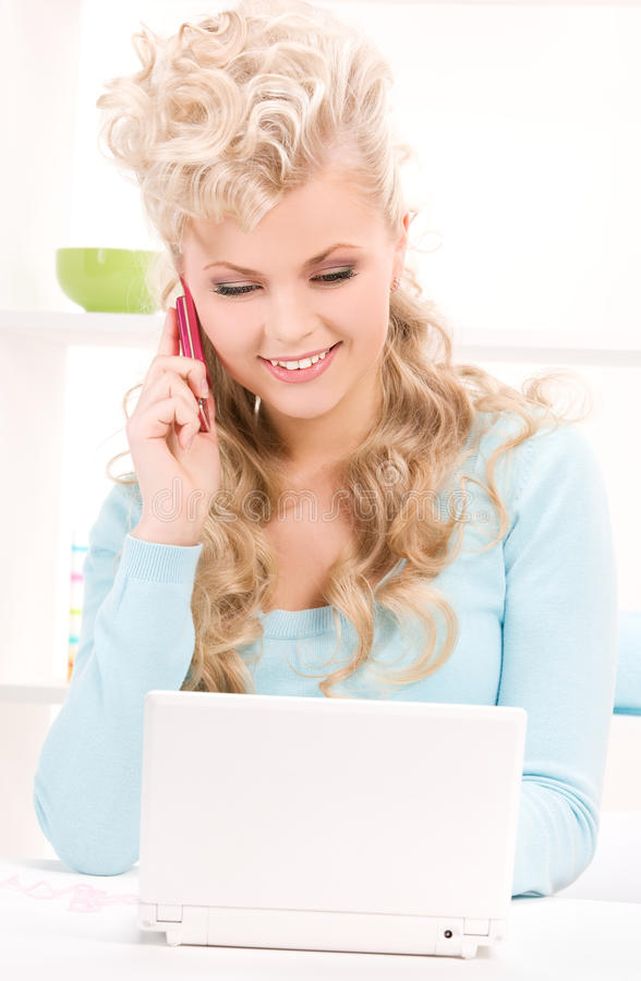 Download Lovely Woman With Cell Phone And Computer Stock Photo - Image of cheerful, friendly: 40474938
