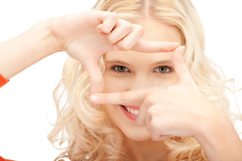 Lovely woman creating a frame with fingers stock photography