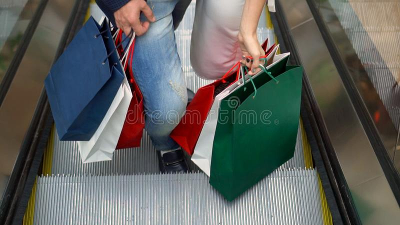 Lovely woman enjoying shopping at the mall with her boyfriend royalty free stock photo