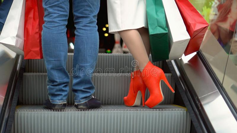 Lovely woman enjoying shopping at the mall with her boyfriend stock image