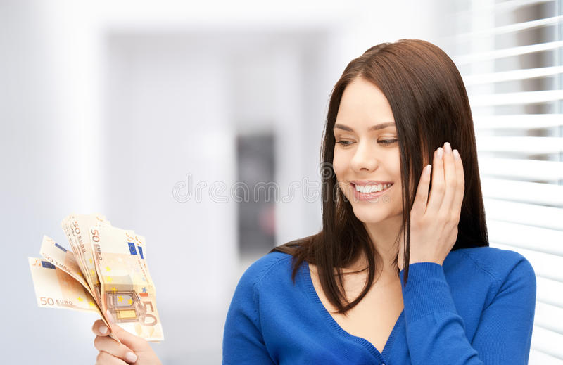 Lovely woman with euro cash money royalty free stock photo