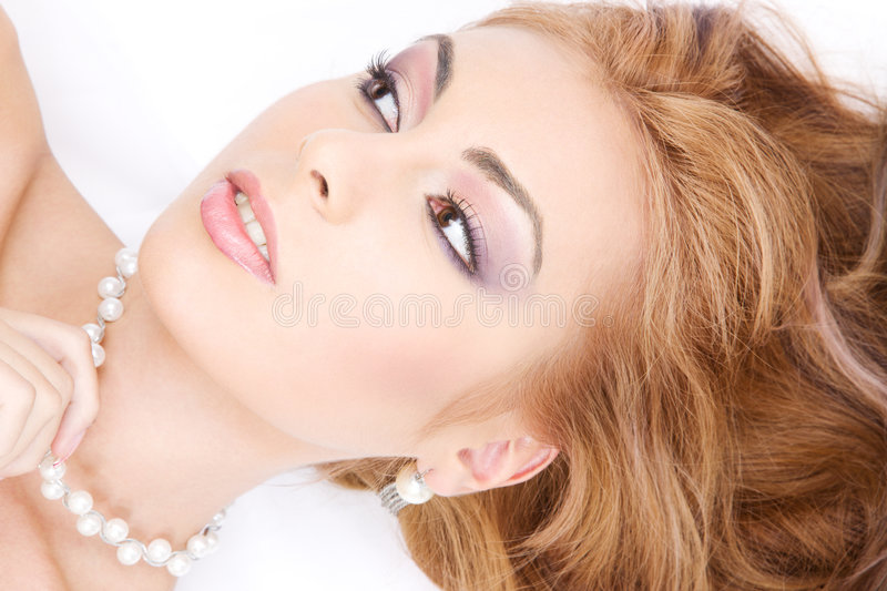 Lovely woman in pearls. Picture of lovely woman in pearls over white royalty free stock photos