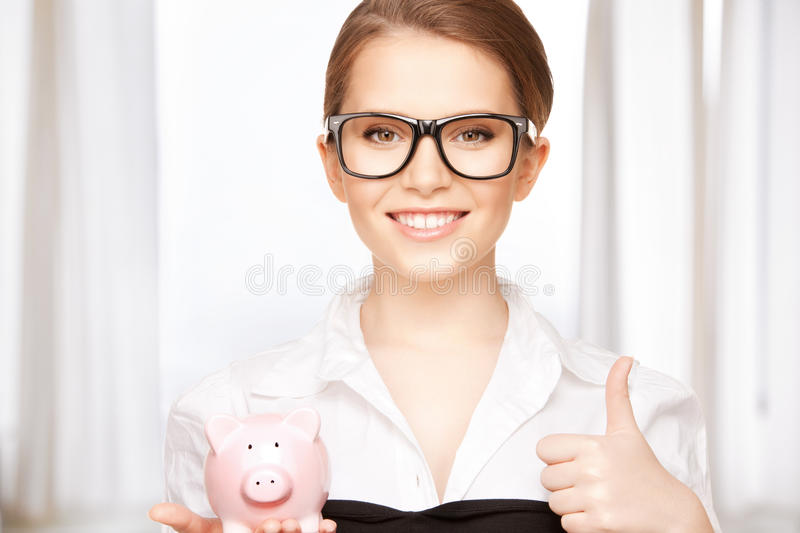 Lovely woman with piggy bank. Picture of lovely woman with piggy bank stock images