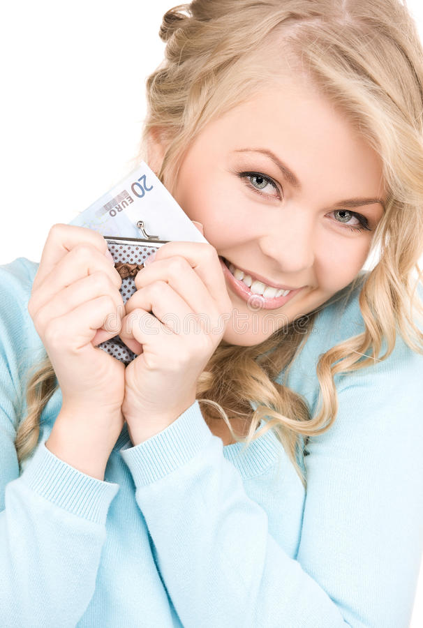 Lovely woman with purse and money royalty free stock image