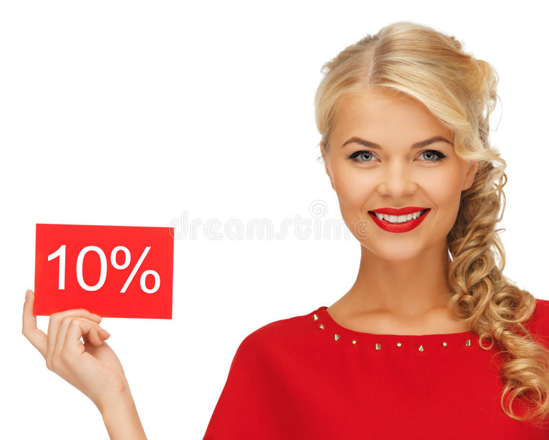 Lovely woman in red dress with discount card royalty free stock image