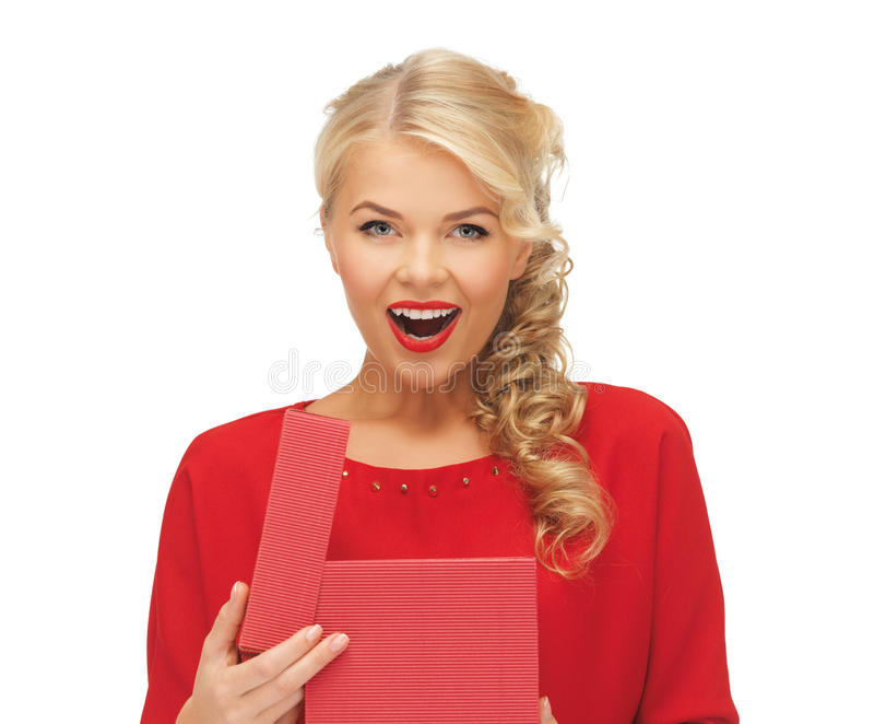 Lovely woman in red dress with opened gift box. Picture of lovely woman in red dress with opened gift box royalty free stock photography