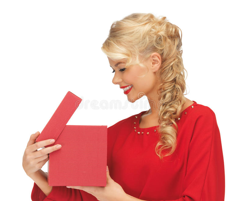 Lovely woman in red dress with opened gift box. Picture of lovely woman in red dress with opened gift box royalty free stock image