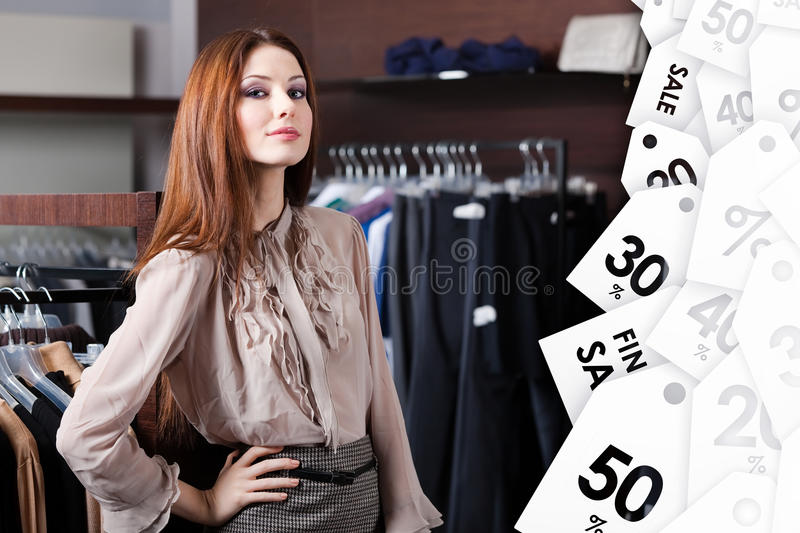 Lovely woman is in the shopping center stock image