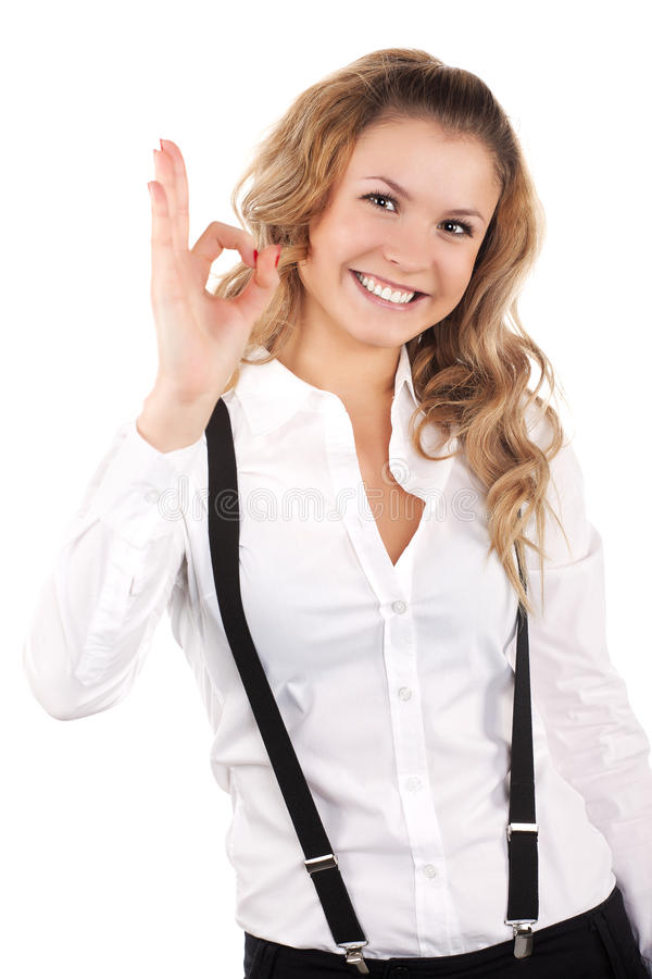 Lovely woman showing ok sign. Isolated stock images