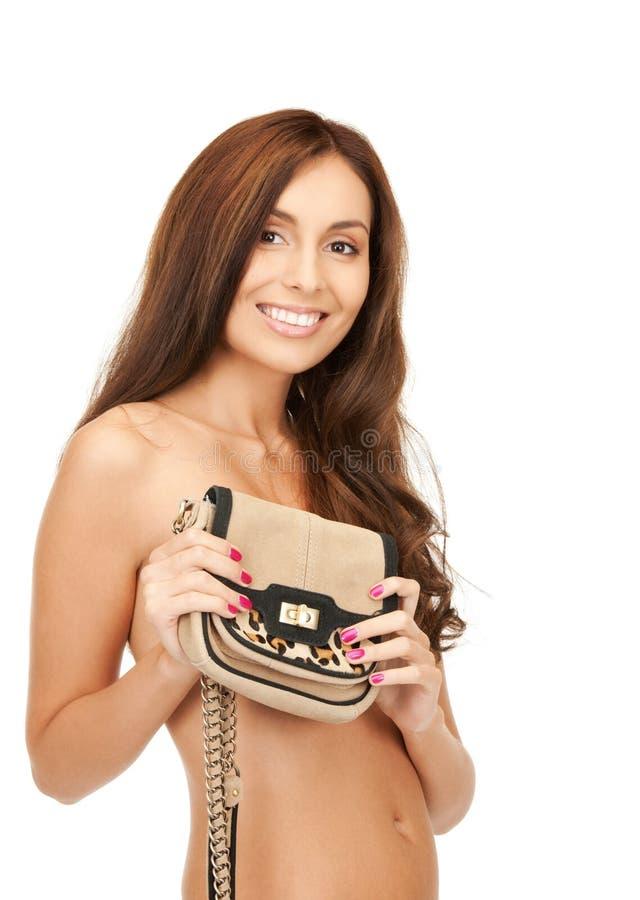 Lovely woman with small handbag royalty free stock photo