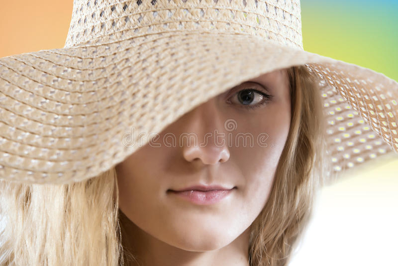 Lovely woman with straw summer hat close up portrait stock image