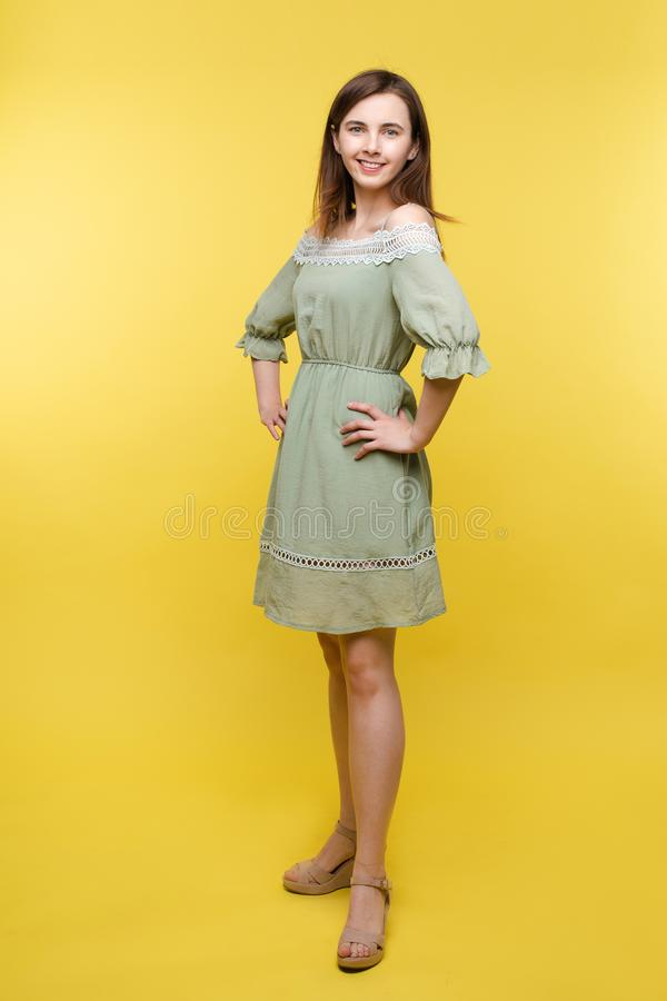 A lovely woman in summer dress.Full length portrait of beautiful cheerful brunette woman royalty free stock photos
