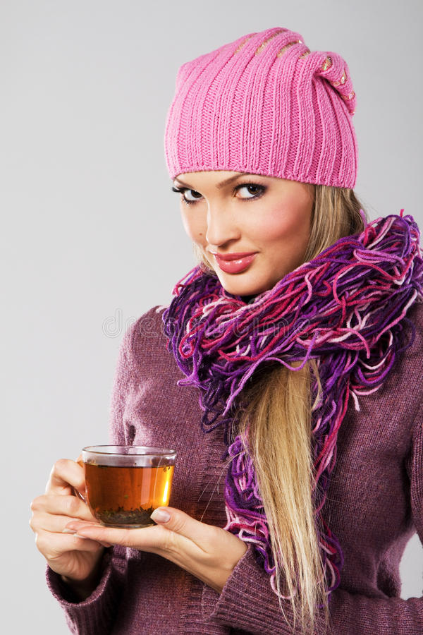 Lovely woman in warm clothing with cup of tea. Portrait of lovely woman in warm clothing with cup of tea stock image