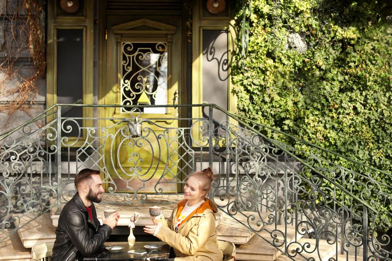 Lovely young couple enjoying tasty coffee at cafe royalty free stock images