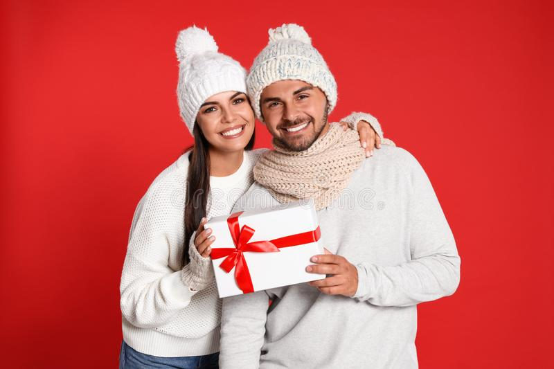 Lovely young couple with gift box. Christmas celebration royalty free stock photos