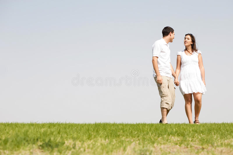 Download Lovely Young Couple Holding Hands And Walking Stock Image - Image: 11695473