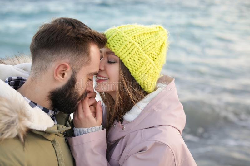 Lovely young couple near sea. Space for text royalty free stock images