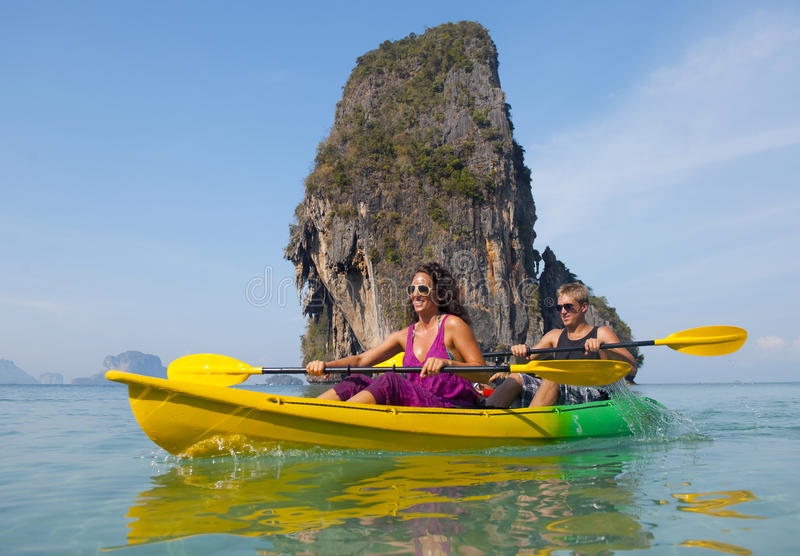 Lovely young couple sea kayaking.  stock image
