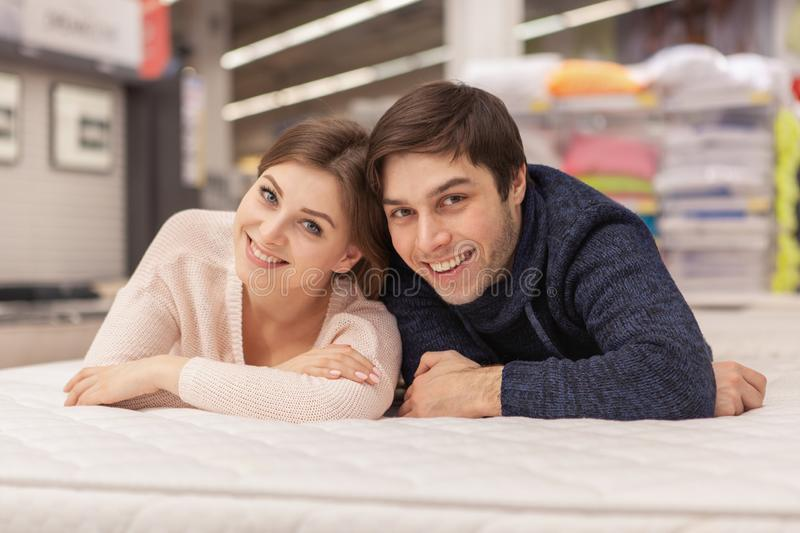 Lovely young couple shopping at home furnishings store stock photos