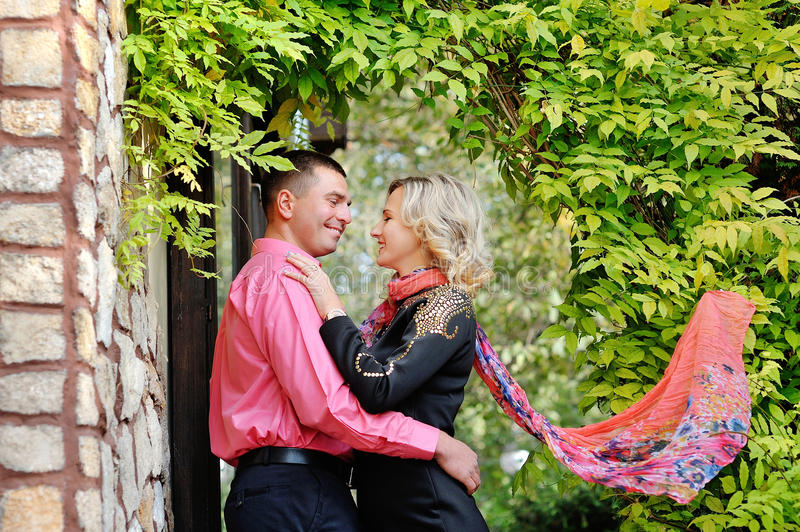 Lovely young couple teenagers in love, kiss outdoors royalty free stock image
